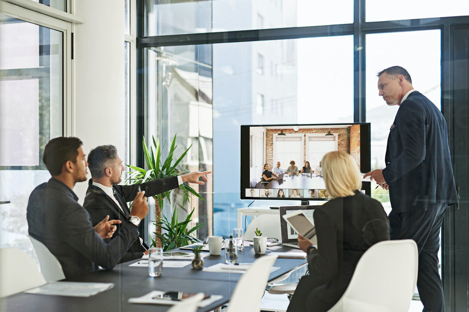 Shot of a group of executives in a presentation - Zoom Blog
