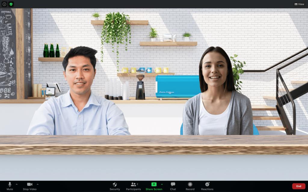 La vista immersiva di Zoom mostra due partecipanti alla riunione in una singola scena di un caffè virtuale